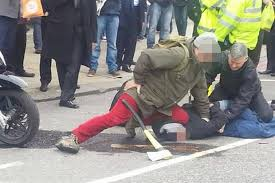 An Axe-Wielding Robber is Grappled by a Brave Man from the Public