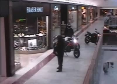 The axe wielding robbers carry out daytime motorbike raid in shopping-centre