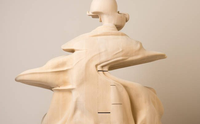 A Wooden Sculpture Explores the Concepts of Time and Thought