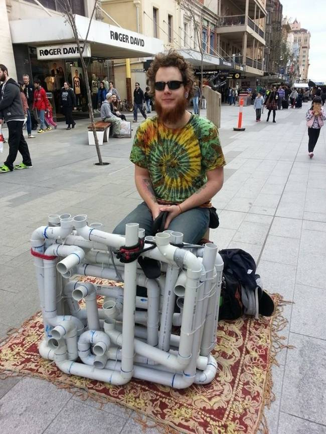 Street Performer Makes Music With Pipes And A Pair Of Flip Flops