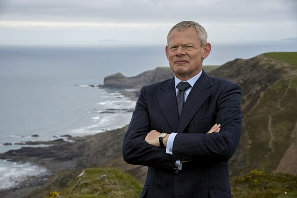 Martin Clunes plays the disgruntled Dr Ellingham in the popular ITV series Doc Martin. Pictured behind him are the cliffs of Port Isaac